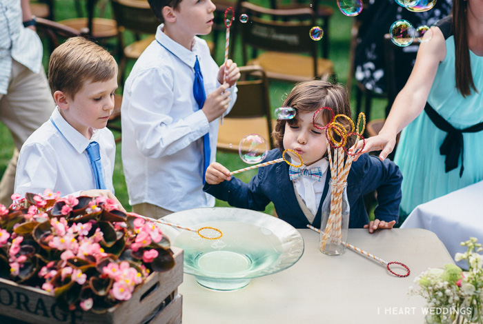 blowing bubbles at a wedding